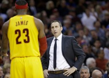 Cleveland Cavaliers head coach David Blatt, right, talks with Cleveland Cavaliers' LeBron James during an NBA basketball game against the San Antonio Spurs Wednesday, Nov. 19, 2014, in Cleveland. (AP Photo/Tony Dejak) ORG XMIT: OHTD10