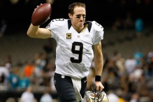 NEW ORLEANS, LA - SEPTEMBER 30:  Drew Brees #9 of the New Orleans Saints celebrates after defeating the Miami Dolphins 38-17 at the Mercedes-Benz Superdome on September 30, 2013 in New Orleans, Louisiana.  (Photo by Chris Graythen/Getty Images)